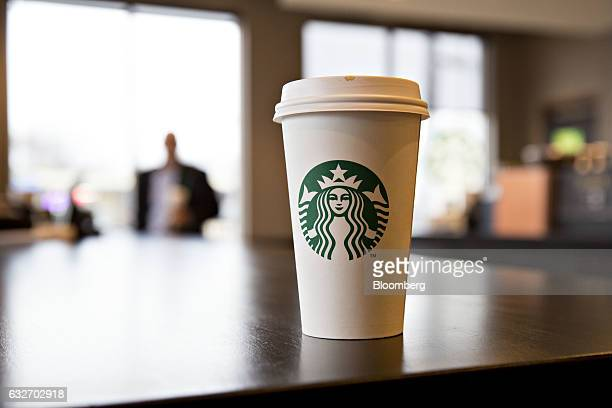 A logo is displayed on a cup inside a Starbucks Corp coffee shop in Peoria Illinois US on Wednesday Jan 25 2017 Starbucks Corp is expected to release...