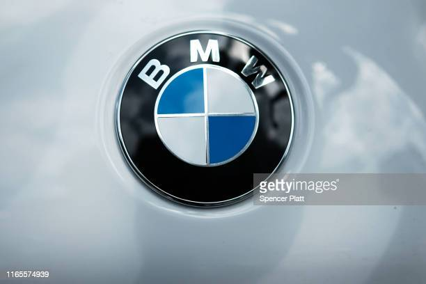 BMW logo is displayed on a vehicle in Manhattan on August 01 2019 in New York City Blaming slowing sales in the US China and Europe BMW announced...