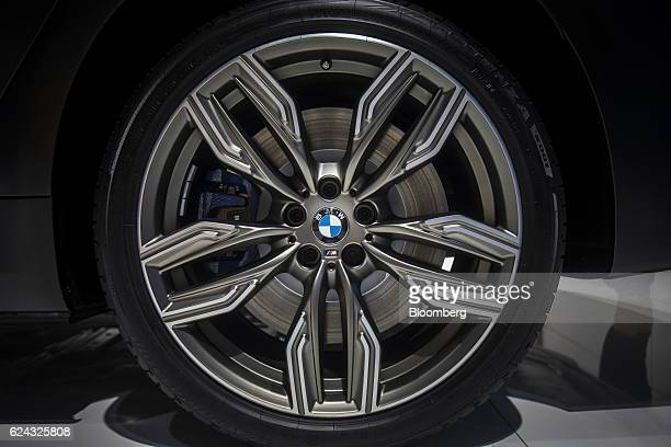 A logo is displayed on a wheel hub of a BMW M760Li sedan produced by Bayerische Motoren Werke AG on display at the China International Automobile...