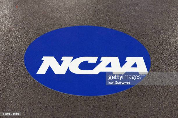 Logo is displayed on the floor during the NCAA Men's Gymnastics Championship on April 19 at the State Farm Center in Champaign, Illinois.