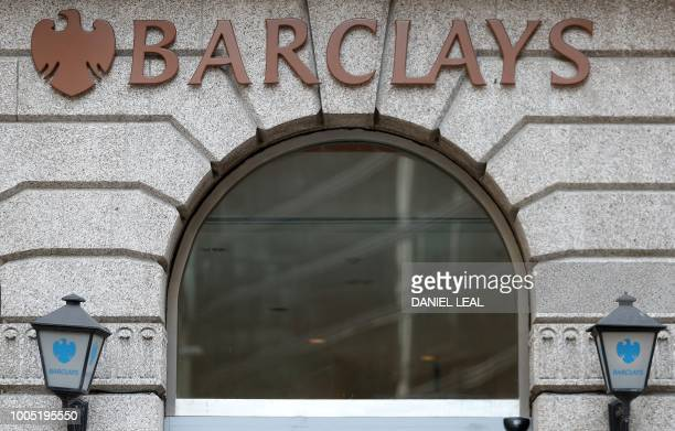A logo is picture above a branch of Barclays bank in central London on July 25 2018