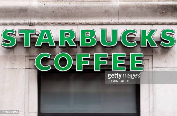 A logo is pictured above a Starbucks coffee shop in London on November 15 2017 / AFP PHOTO / Justin TALLIS
