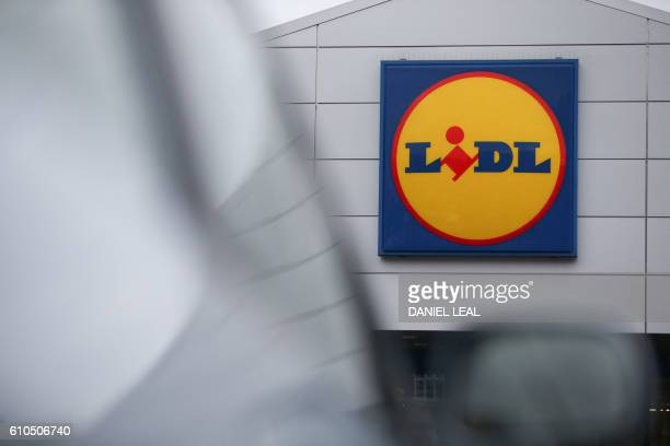 Logo is pictured on a sign outside a Lidl supermarket store in London on September 26, 2016. - Aldi UK announced on Monday that it will invest £300...