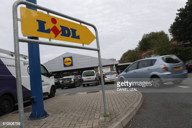A logo is pictured on a sign outside a Lidl supermarket store in London on September 26 2016 Aldi UK announced on Monday that it will invest £300...