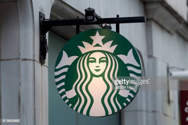 A logo is pictured on a sign outside a Starbucks coffee shop in London on November 15 2017 / AFP PHOTO / Justin TALLIS
