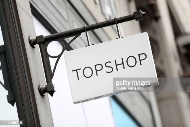 Logo is pictured on a sign outside a Topshop store, operated by Arcadia, in London on June 12, 2019. - Landlords and other creditors were on...
