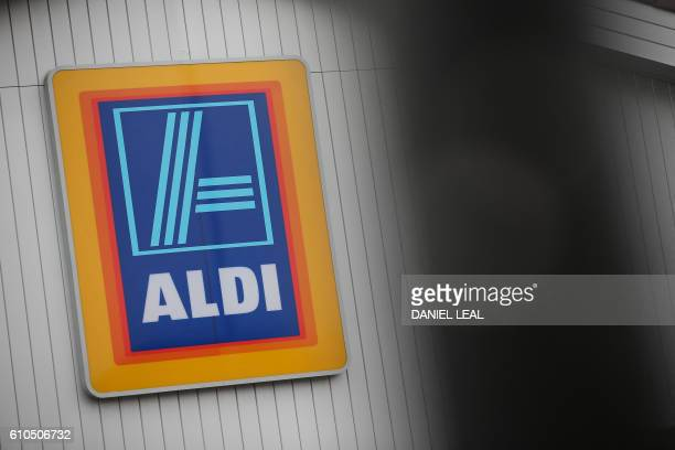 A logo is pictured on a sign outsude an Aldi supermarket store in London on September 26 2016 Aldi UK announced on Monday that it will invest £300...