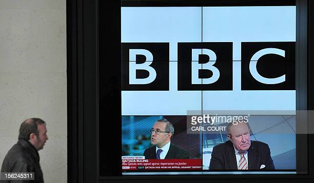 A BBC logo is pictured on a television screen inside the BBC's New Broadcasting House office in central London on November 12 2012 The BBC announced...