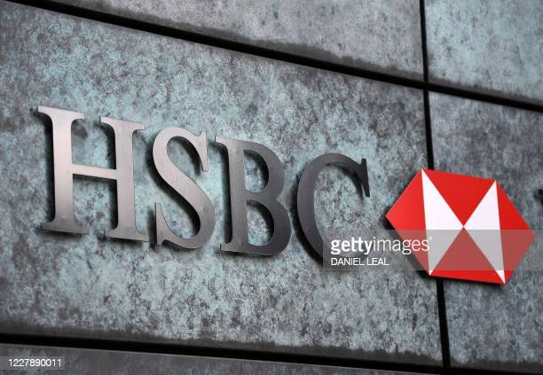 Logo is pictured on a wall outside a branch of the bank in central London on August 3, 2020. - HSBC on Monday revealed a 69-percent slump in net...