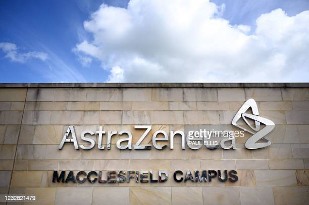 Logo is pictured on a wall outside the offices of pharmaceutical company AstraZeneca in Macclesfield, central England on May 11, 2021. - British...