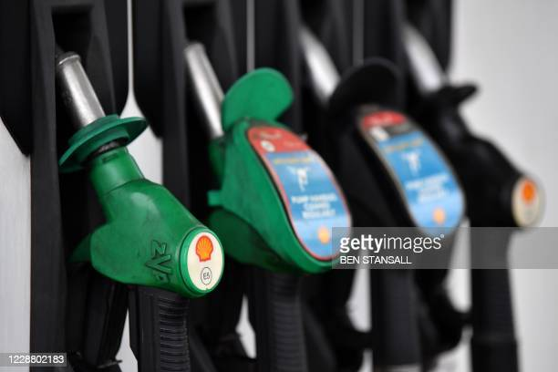 Logo is pictured on an Unleaded fuel pump at a Shell petrol station in Etlham, southeast London on September 30, 2020. - Royal Dutch Shell will axe...