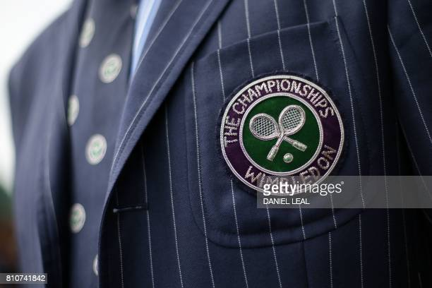 A logo is pictured on the jacket of a court official at The All England Lawn Tennis Club in Wimbledon southwest London on July 8 2017 on the sixth...
