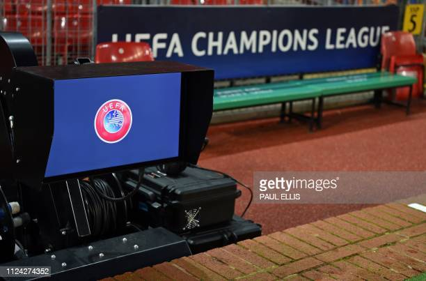 A UEFA logo is pictured on the screen of VAR equipment at the side of the pitch ahead of the first leg of the UEFA Champions League round of 16...