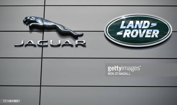 A logo is pictured outside a Jaguar Land Rover new car show room in Tonbridge south east England on May 24 2020 Jaguar Land Rover owned by India's...