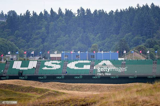Logo is seen across a grandstand during a practice round prior to the start of the 115th U.S. Open Championship at Chambers Bay on June 16, 2015 in...