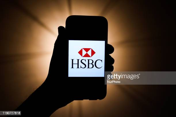 HSBC logo is seen displayed on a phone screen in this illustration photo taken in Krakow Poland on December 26 2019