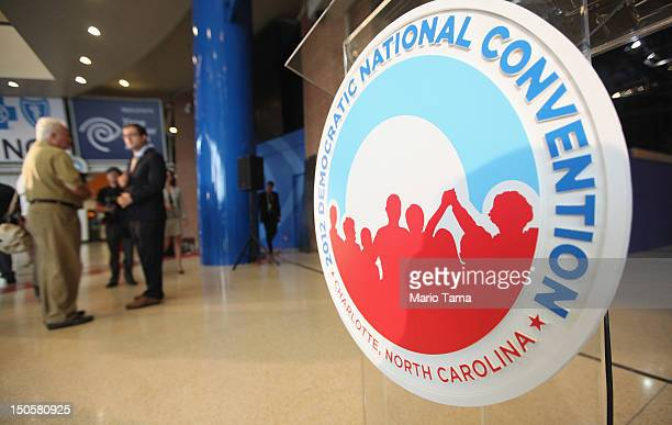 A logo is seen near where workers construct modifications to the Time Warner Cable Arena in preparation for the Democratic National Convention on...