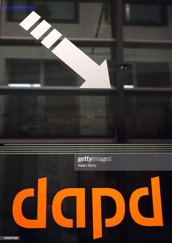 A logo is seen on a door at the offices of the German news agency dapd on March 4, 2013 in Berlin, Germany. The country's second-largest news agency, dapd, was forced to declare insolvency for the second time in five months on March 1.