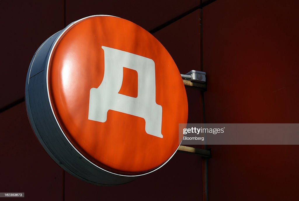 A logo is seen on a sign hanging outside a supermarket operated by OAO Dixy Group in Moscow, Russia, on Friday, Feb. 22, 2013. Russia's largest retailer by market value, OAO Magnit, is spending as much as $1.8 billion this year to compete against X5 Retail Group NV and OAO Dixy Group. Photographer: Andrey Rudakov/Bloomberg via Getty Images