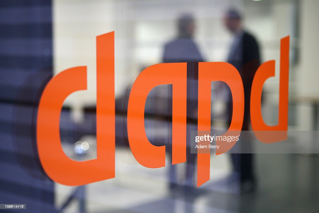 A logo is seen on the door of the headquarters of the dapd news agency on December 21, 2012 in Berlin, Germany. The financial newswire Dow Jones is to replace Associated Press as an international distribution partner for the insolvent news agency dapd. Former CEO of N24 television Ulrich Ende is serving as a new investor in Germany's second-largest news agency, which declared bankruptcy in October and fired one hundred, or one-third, of its employees the following month.
