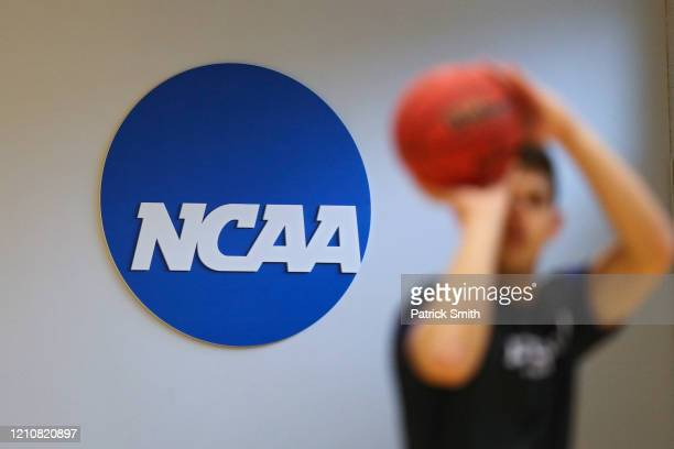 NCAA logo is seen on the wall as Yeshiva players warmup prior to playing against Worcester Polytechnic Institute during the NCAA Division III Men's...