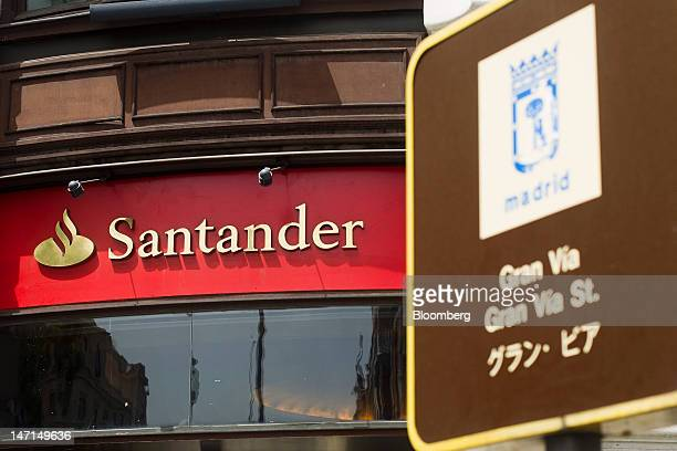 A logo is seen outside a Banco Santander SA branch on Gran Via in Madrid Spain on Tuesday June 26 2012 Banco Santander SA and Banco Bilbao Vizcaya...