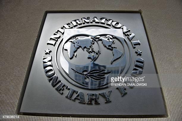 Logo is seen outside the headquarters of the International Monetary Fund June 30, 2015 in Washington, DC. AFP PHOTO/BRENDAN SMIALOWSKI