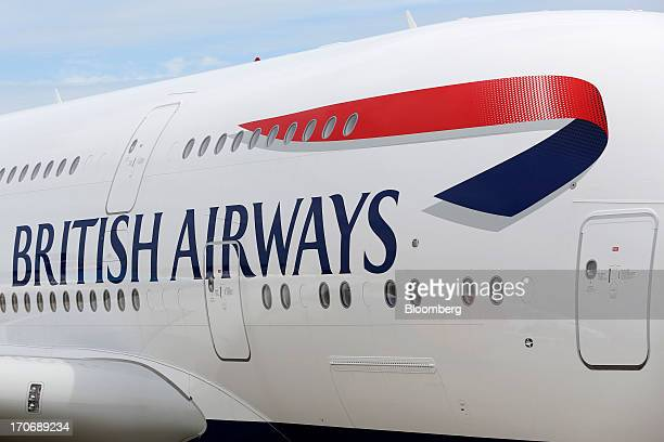 A logo its above cabin windows on an Airbus SAS A380 aircraft operated by British Airways prior to the opening of the Paris Air Show in Paris France...
