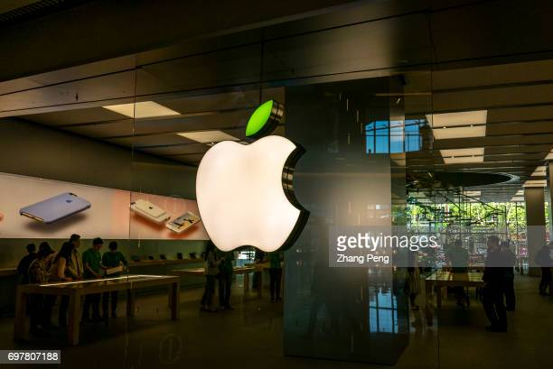 Logo light box of the Apple store located on the Huaihai road The leaf on the apple logo changes to green to celebrate the Earth Day