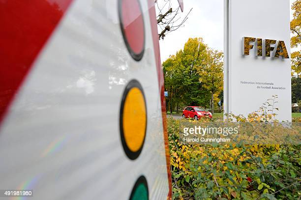 FIFA logo next to a traffic light sign at the entrance of the FIFA headquarters on October 9 2015 in Zurich Switzerland On Thursday FIFA's Ethics...