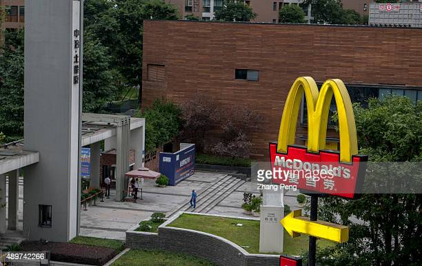 Logo of a McDonald's DriveThrough Restaurant directing the entrance for drivers A McDonald's DriveThrough Restaurant at roadside MacDonald's has...