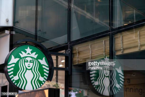 Logo of a Starbucks coffee shop According to Starbucks financial report of the third quarter in 2018 it suffered the first decline on Chinese market...