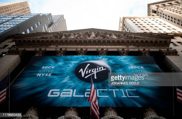 Logo of a Virgin Galactic is seen outside the building during the company's first day of trading on the New York Stock Exchange on October 28, 2019...