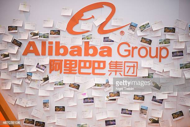 A logo of Alibaba Group and postcards of visitors are pictured at the 2015 CeBIT technology trade fair on March 20 2015 in Hanover Germany China is...