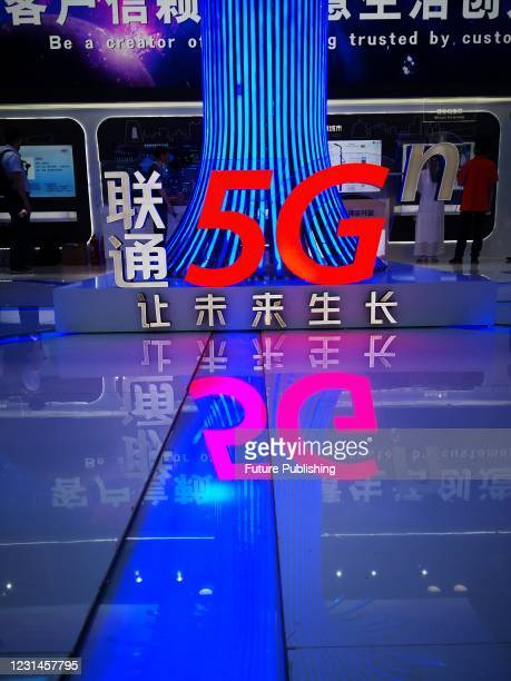 Logo of an Oppo mobile phone store at the Huaxi Center in Wukesong, Beijing, China, Jan 28, 2021. By the end of 2020, China will have 718,000 5G base...