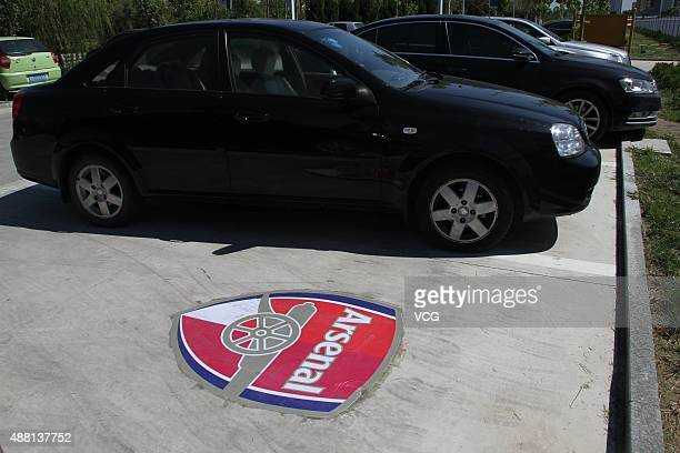 A logo of Arsenal Football Club is painted on the ground of the parking space at a football park on September 13 2015 in Binzhou Shandong Province of...