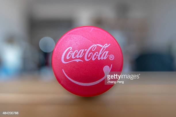 Logo of CocaCola on a bottle cap The strong dollar hit CocaColas overseas operations particularly in China