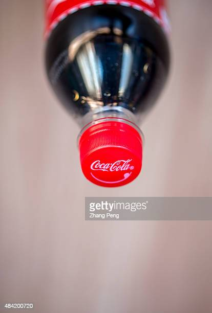 Logo of CocaCola on bottle cap The strong dollar hit CocaColas overseas operations particularly in China