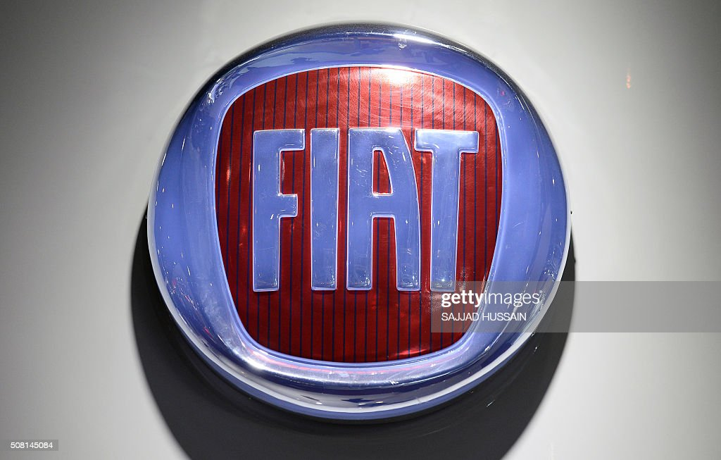 A Logo Of Fiat Is Pictured At The Indian Auto Expo 2016 In Greater