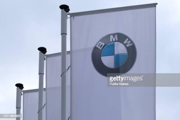 Logo of German carmaker BMW is pictured on a flag outside its dealer on April 26, 2020 in Noordwijk, Netherlands.