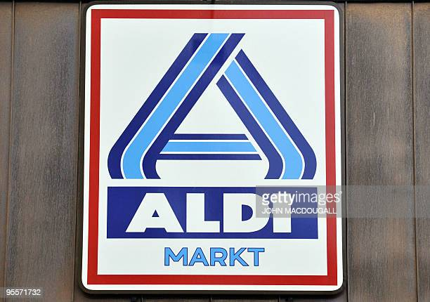 A logo of German discount supermarket chain Aldi hangs on one of their outlets in Berlin on April 9 2008 AFP PHOTO JOHN MACDOUGALL