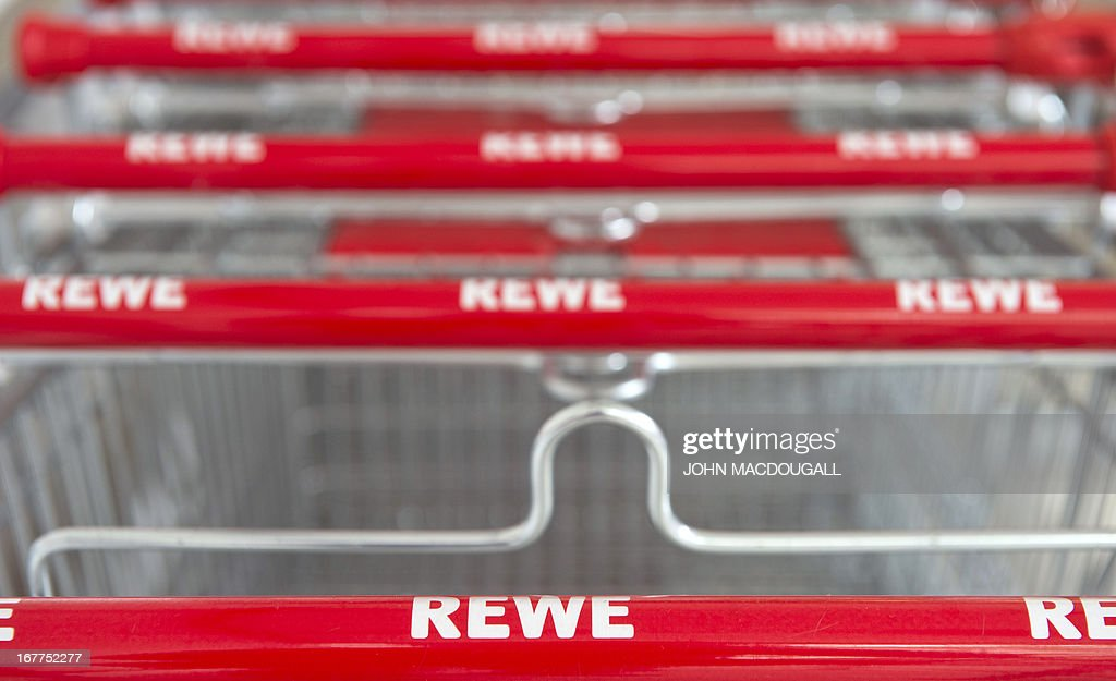 A logo of German supermarket chain REWE appears on trolleys at one of their outlets in Berlin April 29, 2013. Employees were temporarily monitored illegally at Penny south, a discount subsidiary of Rewe, the company admitted on April 29, 2013.