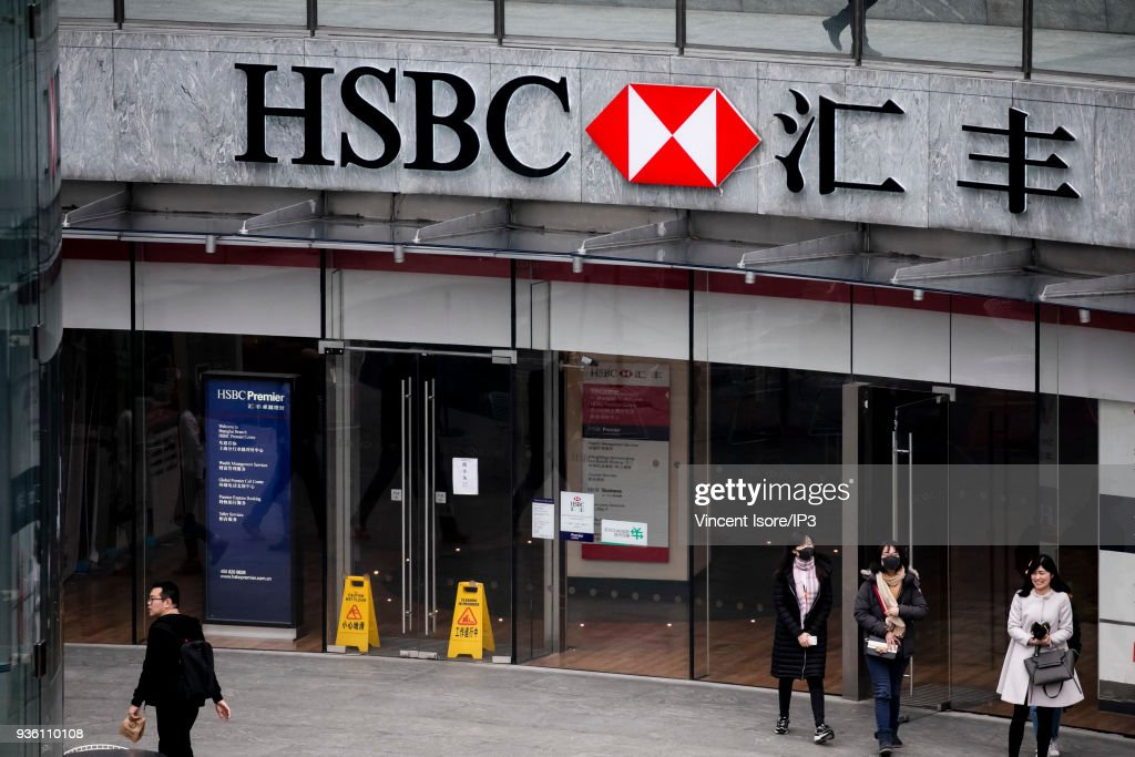Logo of HSBC Bank at the entrance of a skyscraper in the