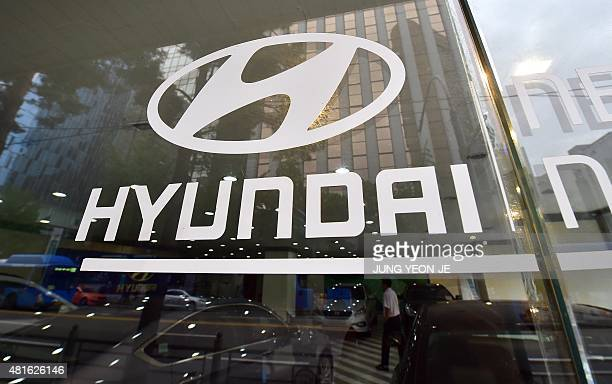 A logo of Hyundai Motor is seen on a glass door at a company branch in Seoul on July 23 2015 Hyundai Motor Co said on July 23 its secondquarter net...
