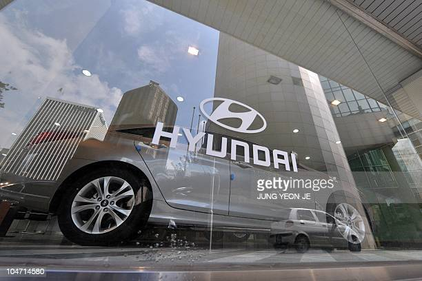 A logo of Hyundai Motor is seen on a glass window at its branch in Seoul on September 27 2010 South Korea's top automaker Hyundai Motor is recalling...