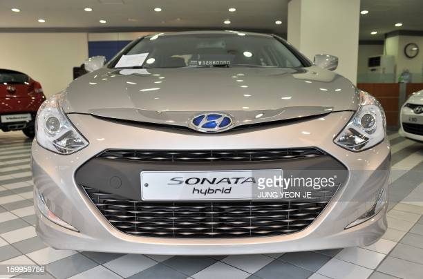 A logo of Hyundai Motor is seen on the Sonata hybrid car at its branch in Seoul on January 24 2013 South Korea's Hyundai Motor reported a 12 percent...