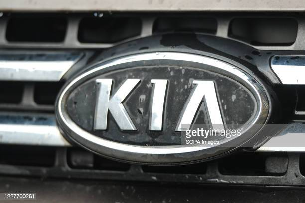 Logo of KIA, a South Korean multinational automobile manufacturer, seen on a parked car in Krakow.