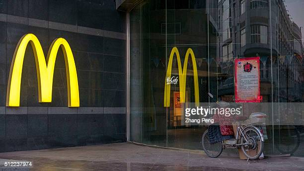Logo of McDonald's is reflected on shop window McDonalds announced its fourthquarter samestore sales of 2015 in China rose 4% a second straight...