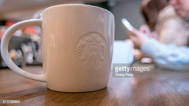 Logo of Starbucks on a coffee mug Starbucks already has nearly 2000 stores in mainland China and plans to have 3400 by 2019 laying the groundwork for...