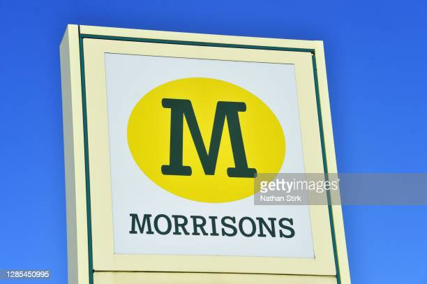 Logo of Supermarket company, Morrisons is seen outside one of its stores on November 13, 2020 in Newcastle-Under-Lyme, Staffordshire .